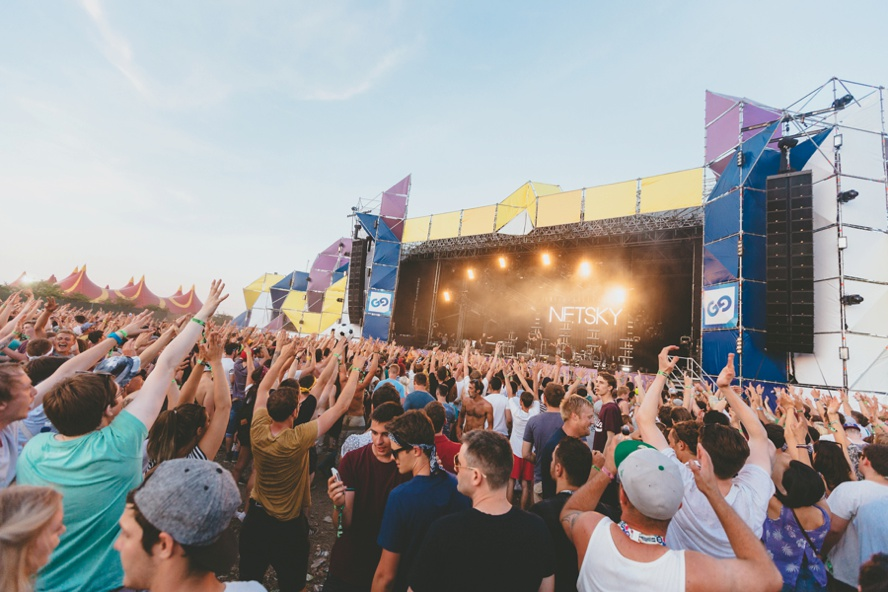 Crowd hands in air festival photo