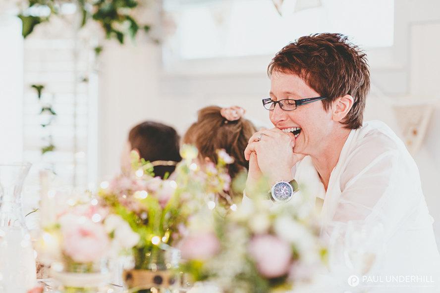 Bride laughing gay weddings