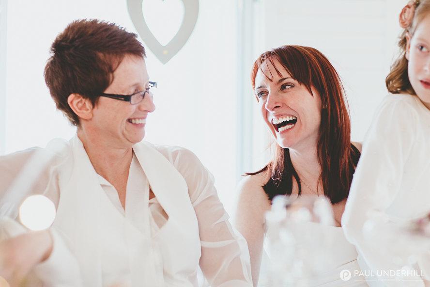 Brides laughing gay wedding photography