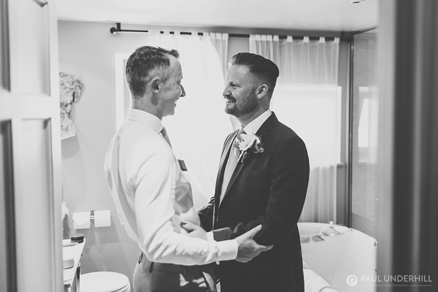 Candid photo grooms at gay wedding