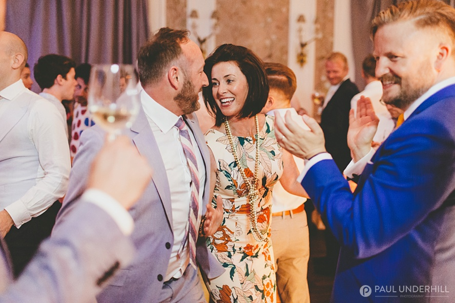 Candid photo of wedding guests dancing