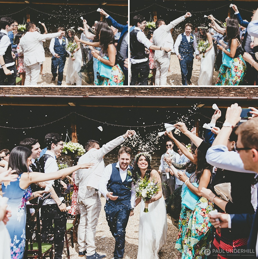 Confetti throwing at barn wedding