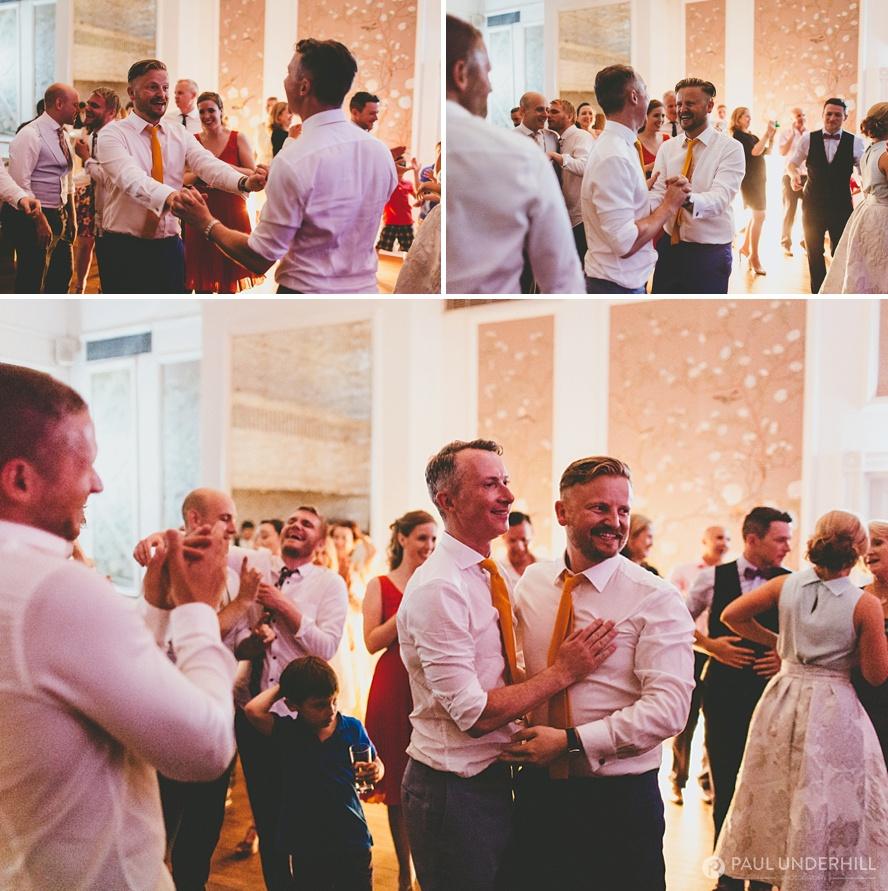 Gay wedding grooms dance