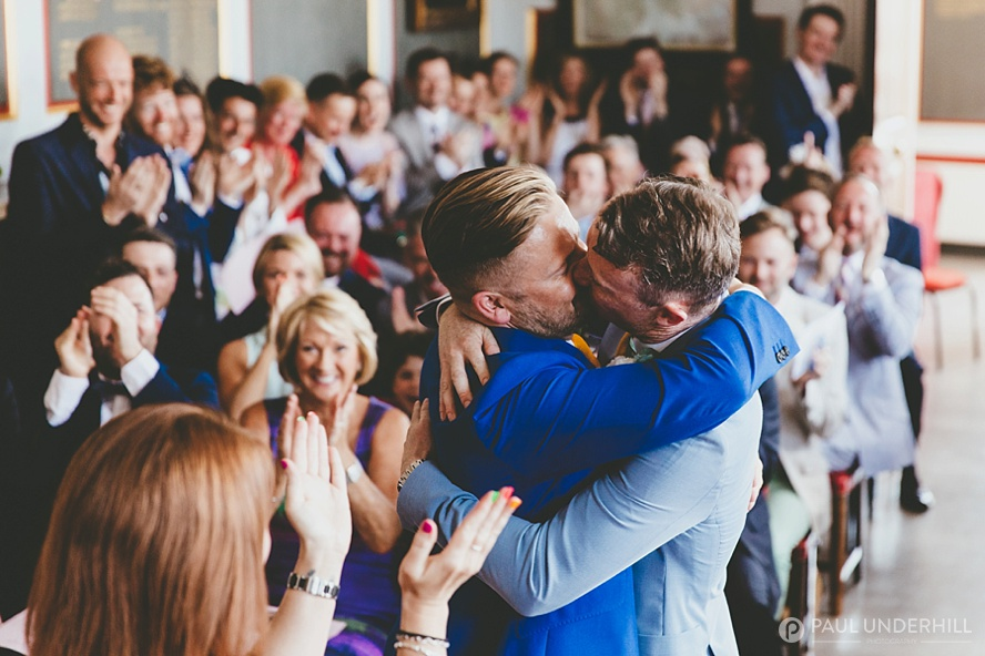 Grooms kiss gay wedding