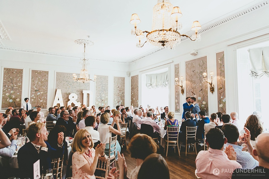 Guests applaud wedding speech