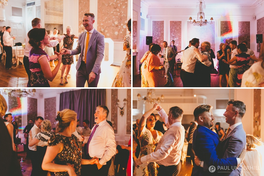 Guests dancing at gay wedding