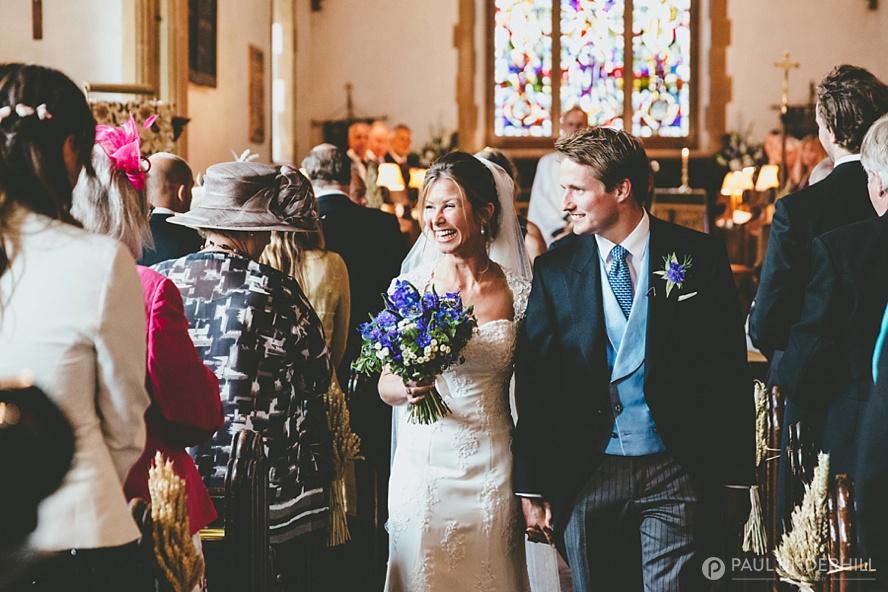Happy couple leave church
