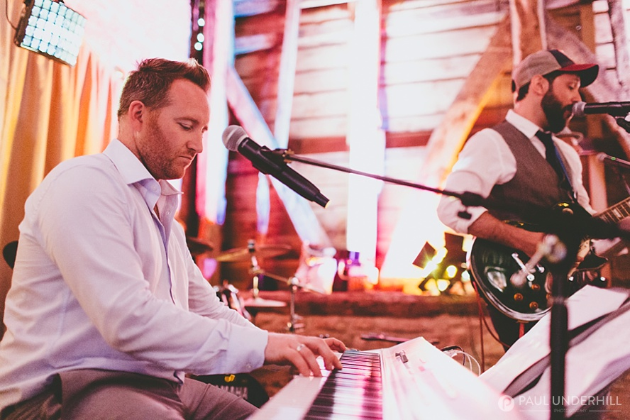 Live band perform at barn wedding in Dorset