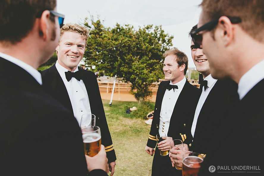 Navy men in uniform at wedding
