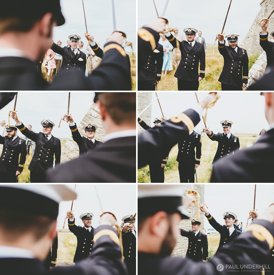 Navy men with swords for honour guard