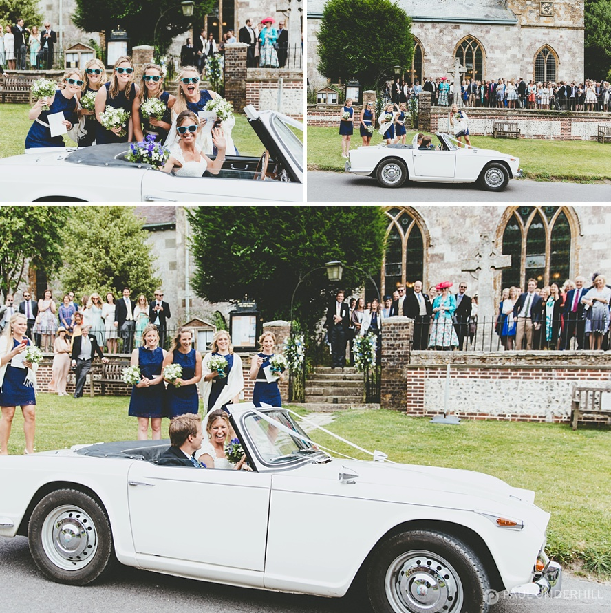 Vintage wedding car leaves church