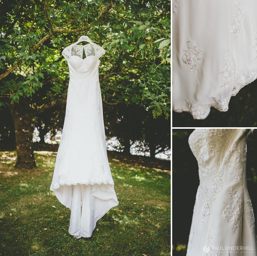 Wedding dress photographed outside on farm