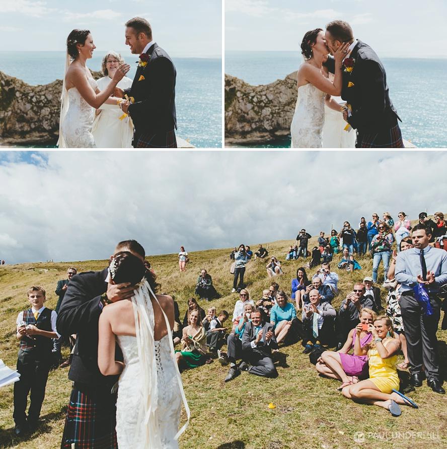 Bride and groom get married at Durdle Door in Dorset