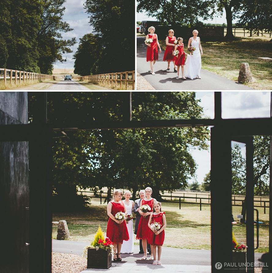 Bride arrives at Barford Park farm wedding