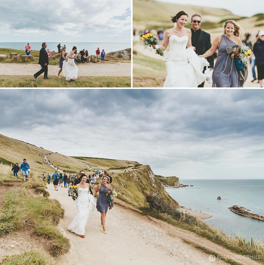 Bride walks to Durdle Door wedding ceremony