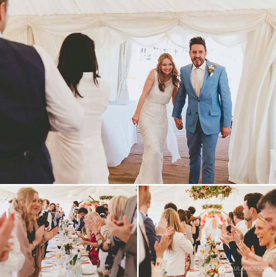 Bride and groom enters wedding marquee