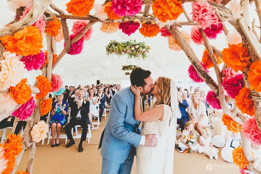 Bride and groom kiss Bournemouth beach wedding