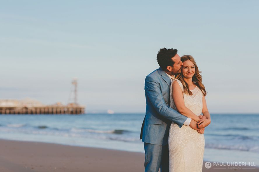 Bride and groom wedding portrait with Bournemouth pier