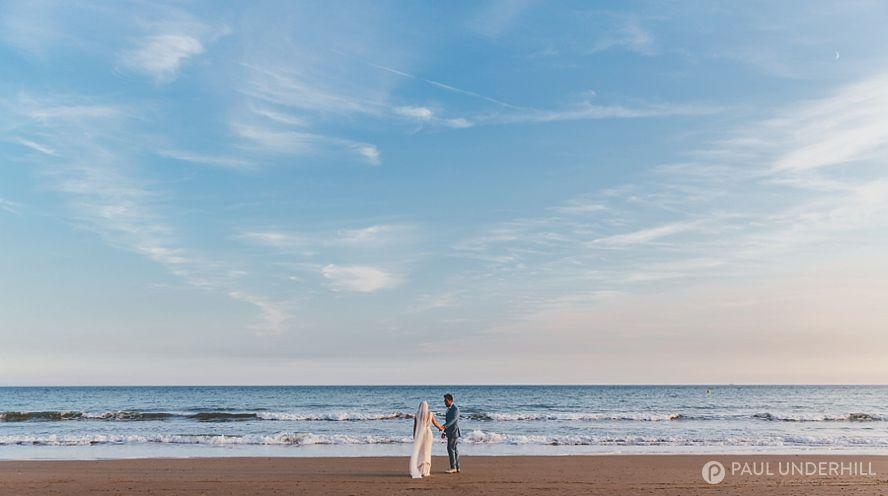 Creative wedding portrait on Bournemouth beach