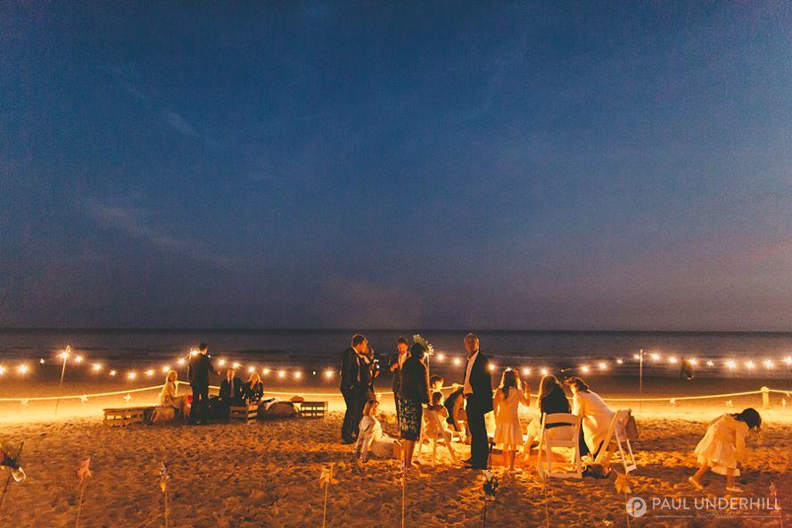 Festoon lighting beach wedding