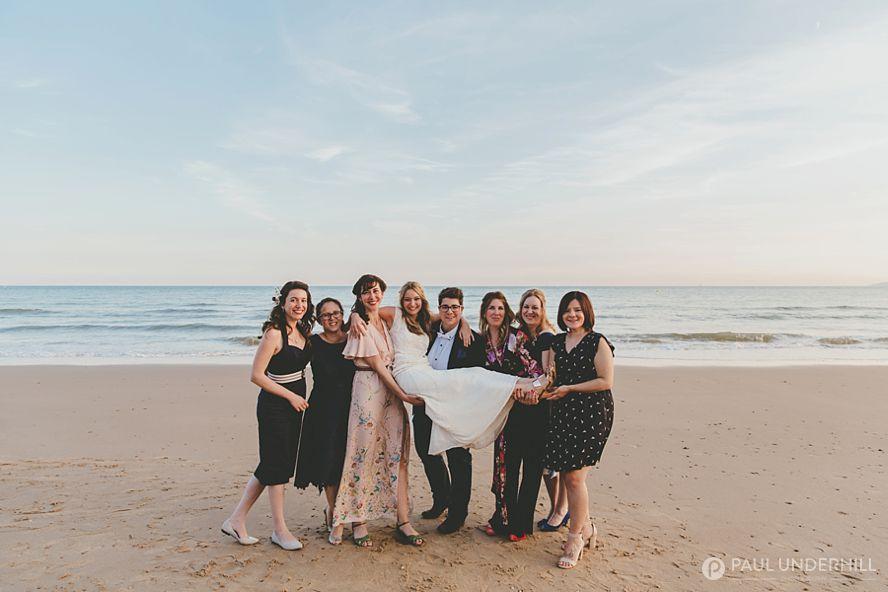 Fun group portrait on the beach