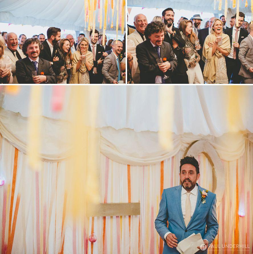 Groom makes speech at beach wedding