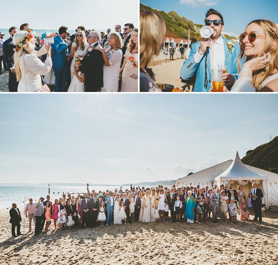 Group photo of wedding guests on Bournemouth beach