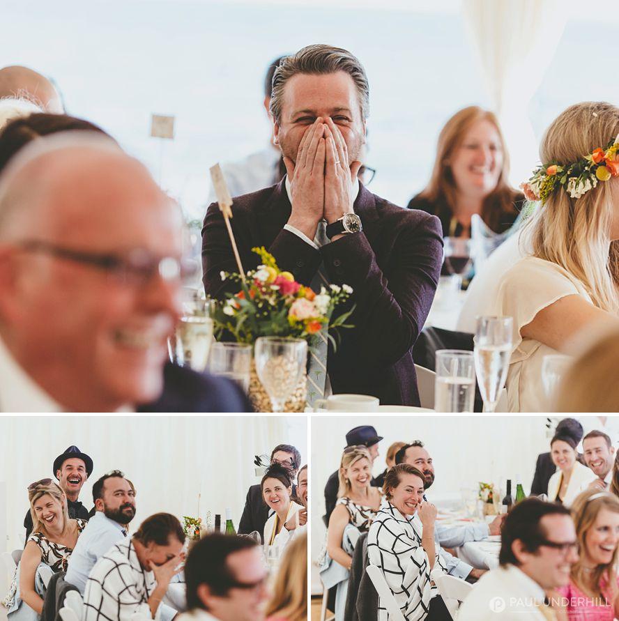 Guests laugh at wedding speech