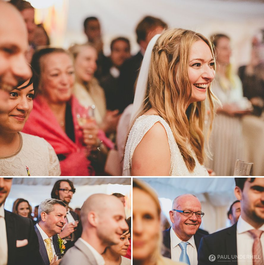 Guests laugh during wedding speech
