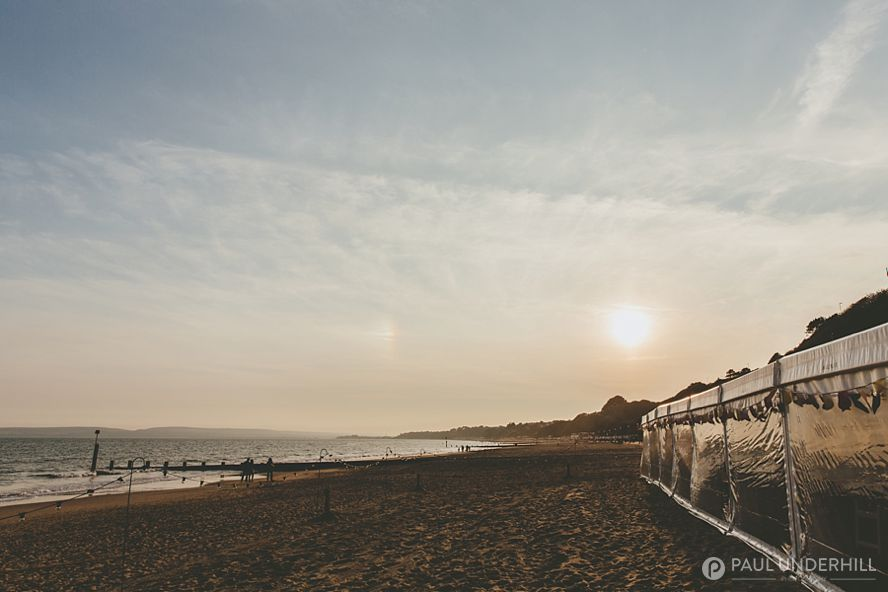 Sunset over Bournemouth beach wedding marquee