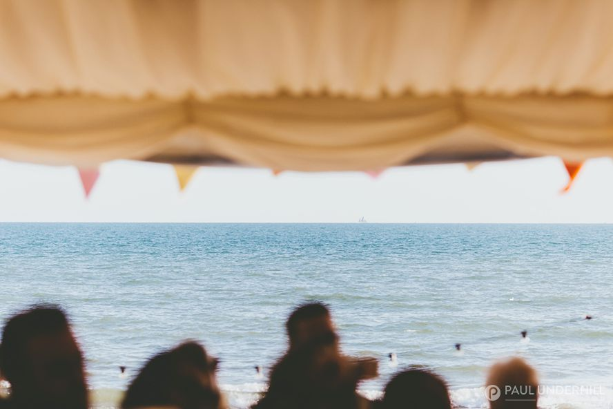 View of the sea from wedding marquee