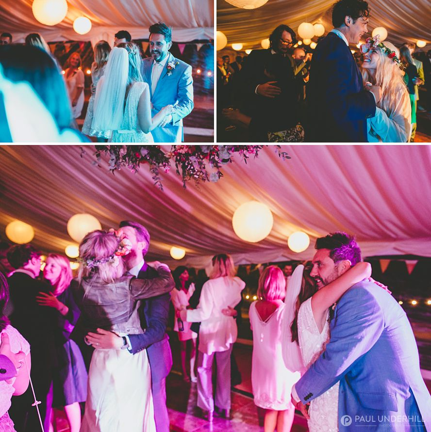 Wedding guests dancing beach wedding
