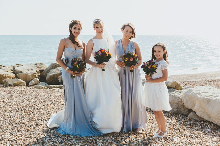 Bride and bridesmaids Highcliffe beach