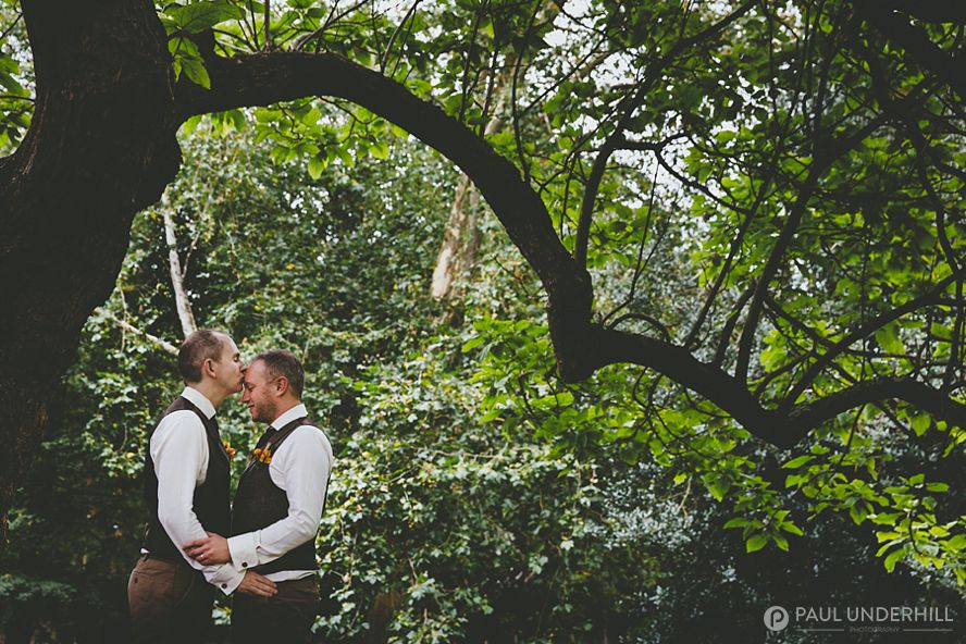 Creative wedding portrait of grooms