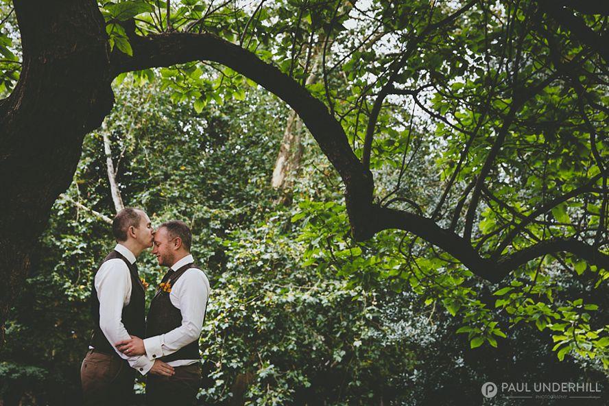 Creative wedding portrait of grooms