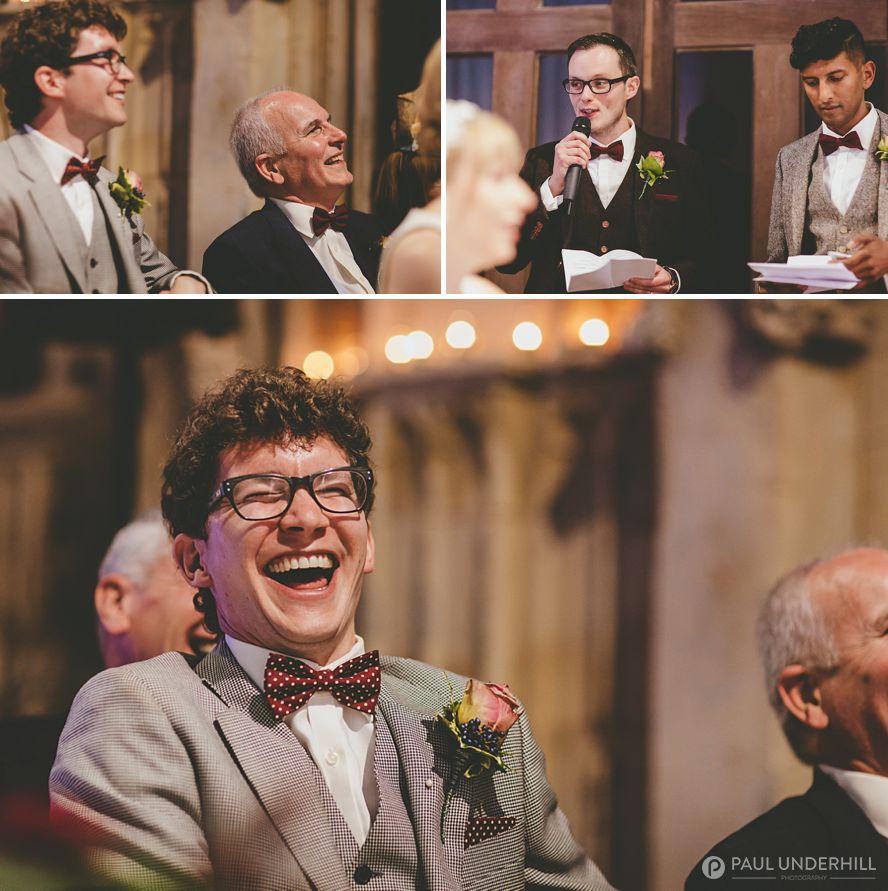 Groom laughing at jokes during speech