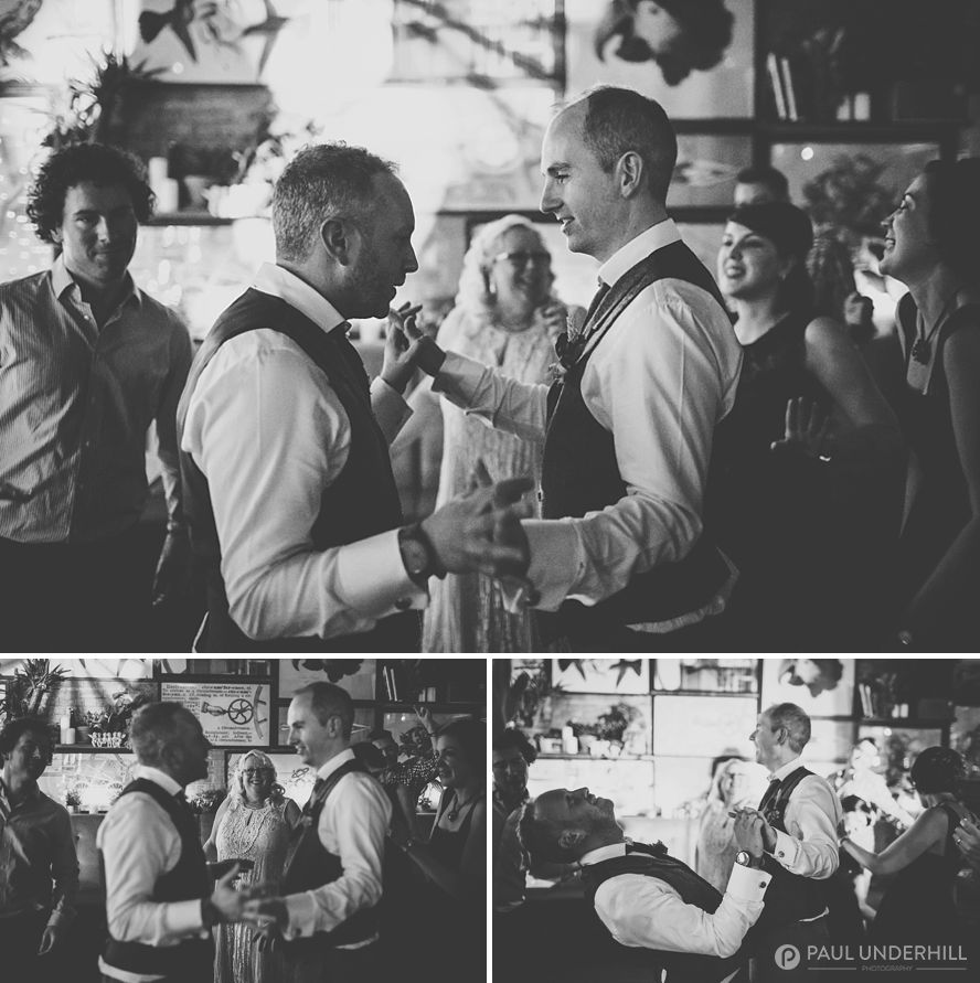 Grooms dancing at London gay wedding