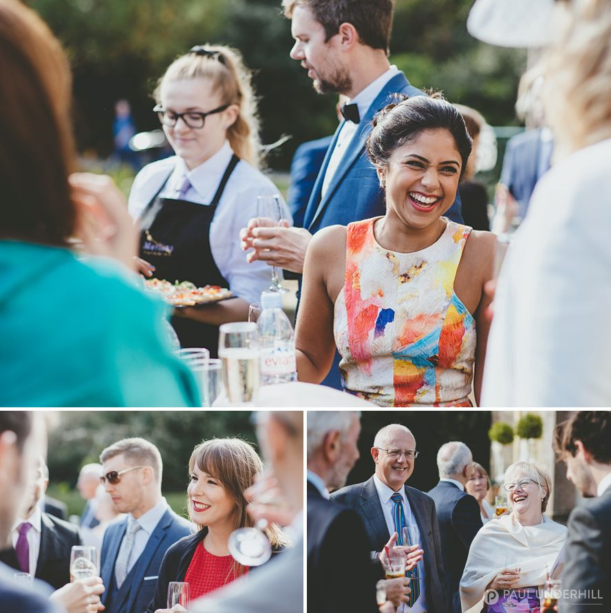 Guests laughing Highcliffe Castle wedding