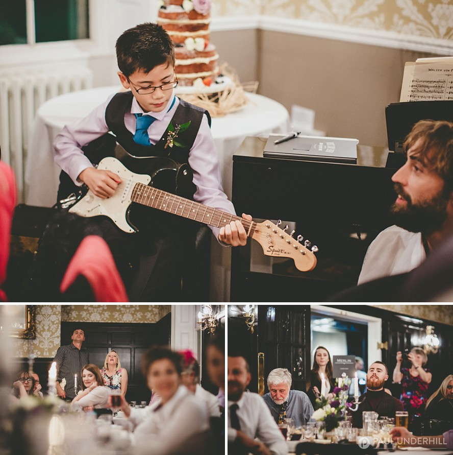 Son of the brides plays guitar at wedding