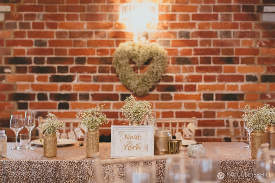 Gold and wild flower wedding decorations